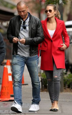 Retired life: Derek Jeter (left) and Hannah Davis (right) enjoyed a leisurely stroll through New York on Wednesday