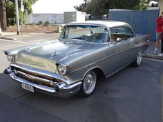 Gorgeous 1957 Chevy in silver! Everyone loves a classic car! #VintageMuscleCars