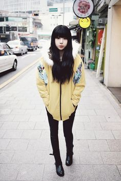 yellow jacket with black tights