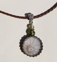 $12.  Upcycled Jewelry.  Flower themed necklace I created with a used bottle cap, beads from an Estate Sale and cut out from a paper label.  One of-a-kind.