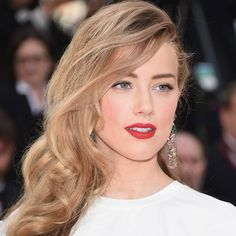 Amber Heard paired flawless, rosy skin with a true red lip. Click here to learn how to recreate the effect.