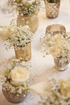 gold votives white flowers baby breath gypsohila tables centrepiece / http://www.deerpearlflowers.com/unique-wedding-centerpiece-ideas/4/