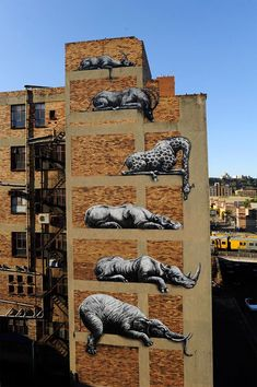 ROA is one of the world's most famous nomadic muralists. Belgian by birth, he travels the globe painting mostly animals indigenous to the country he visits. Find these 6 African beasts (elephant, rhino, hippo, giraffe, sable antelope, & springbok) stacked on top of one another at the corner of Error & Sivewright streets in the Maboneng Precinct. The murals were painted for 'I Art Jo'burg' in 2012.
