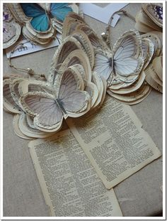 made of recycled paper 2 pencils embellished with feather butterflies by All Things Natural