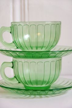 Depression glass cups & saucers