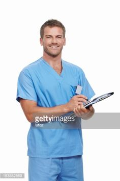 Portrait of a male doctor updating medical reports and smiling on white background