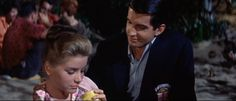 "Merritt Andrews (Dolores Hart): ""I'm not frightened and I'm not being coy. It's just that I've... I've never done anything like this before."" // Ryder Smith (George Hamilton): ""You certainly had me fooled. All that talk."" // Merritt Andrews: ""That's all it was is talk, and unless you love me the way I love you..."" // Ryder Smith: ""I love you, Merritt, I love you."" -- from Where the Boys Are (1960) directed by Henry Levin"