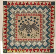 In 2000-2001 Jo Morton made this wall size quilt inspired by antique quilt from mid 19th Century