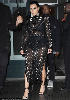 Nice maternity wear! Pregnant Kim Kardashian wears sexy sheer outfit as she arrives with K...