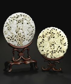 TWO JADE RETICULATED CIRCULAR 'HE HE TWINS' PLAQUES<br>QING DYNASTY, 19TH CENTURY | lot | Sotheby's