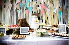 ribbon backdrop, bunting and a beautiful dessert table