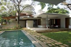 In this unique home in Bangalore, India, the architects at Khosla Associates were asked to strictly apply the rules of Vastu Shasta in the design — traditional Hindu system of design based on directional alignments. According to the architects, the Vatsu requirements dictating the very specific locations of various spaces proved to the be the most difficult part of the design — but the result is a marvelous play on views and natural light in a multi-leveled indoor and outdoor space that…