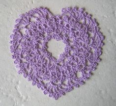 """Purple hearts signify bravery. This doily says, """"My brave heart has a hole in it, and also it's swollen...with love for you."""""""