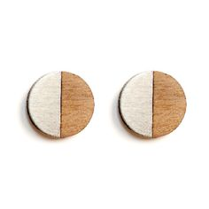 Turpentine Francesca Walnut & Brushed Steel Earrings: These Francesca Walnut & Brushed Steel Earrings are part of a brand new mixed material jewellery collection designed in-house by Jude de Berker and exclusive to the Turpentine.  Inspired by time spent in her dad's carpentry workshop as a child and her training as a jeweller at Central Saint Martins the range mixes solid walnut wood with brushed steel, copper, brass and 100% solid silver earrings backs and findings.  The design…