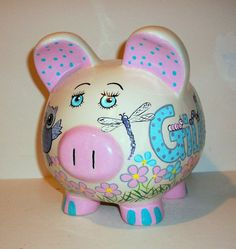 Piggy Bank Hand Painted Large Ceramic Jumbo Bank - Baby Chevron Owls for Boy or Girl in Aqas & Greys Frog Bugs Dragon Flies Baby Owls It has an owl and a baby owl sitting in a tree,three owls are flying,a frog sitting on a Lilly pad in a pond, 2 dragon flies, worms and lady bugs on the lettering, the eyes are painted and the inside of the ears and the feet also. It is all hand painted with acrylic paint for glass and ceramic and heat set at a high temperature. If you would like a diffe...