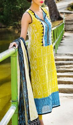 Buy Yellow Embroidered Cotton Lawn Dress by Khaadi Lawn Collection 2015.