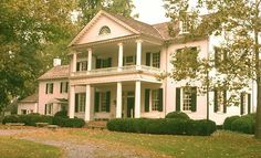 The temple-like pediment over the entry porch gives Rosehill Manor in Maryland a Classical air.