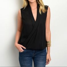 """Black Chiffon Wrap Blouse • S M L This versatile black wrap chiffon blouse is sure to be a closet staple Sleeveless top features a wrapped front with a pleated collar and bubble hem. Can dress up or down! Slight high-low design with rounded hem in back. Available in sizes S, M, L in my closet. Fits TTS  100% Polyester L: 28"""" B: 34"""" W: 38"""" Taken from size Small Bundles are discounted No trades No PP Katana Couture Tops Blouses"""