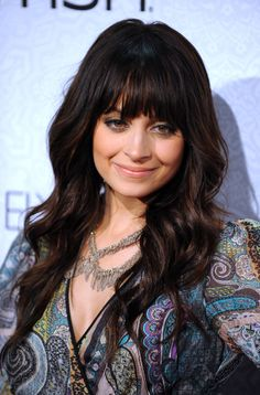 Then she went dark brown again, with straight across bangs. | The Hair Evolution Of Nicole Richie