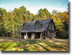 Farm history deeply rooted farms black siding gambrel for Gambrel barns for sale