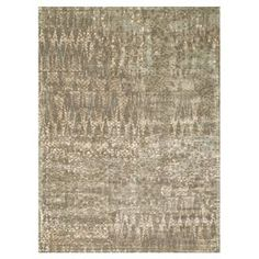 Crafted with wool and art silk, this chic abstract rug effortlessly anchors vibrant decor with its neutral palette.   Product: RugConstruction Material: 50% Wool and 50% art silkColor: MochaFeatures: Machine madeNote: Please be aware that actual colors may vary from those shown on your screen. Accent rugs may also not show the entire pattern that the corresponding area rugs have.Cleaning and Care: Blot spills immediately with a clean sponge or cloth. Vacuum carefully without beater bar…