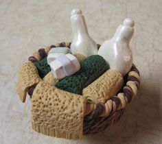 Mini clay basket with towels, soap, and lotions