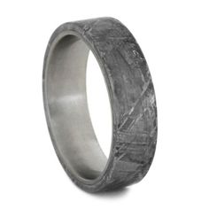 Embark on you journey of love with this stellar Gibeon Meteorite wedding band. The matte-finished titanium ring is overlaid with the rare meteorite ring...