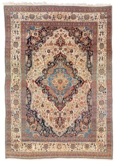KASHAN 'MOHTASHAM' CARPET  CENTRAL PERSIA, CIRCA 1890  Some areas of uneven wear, a few spot stains and touches of moth damage 10ft.11in. x 7ft.7in. (332cm. x 231cm.)