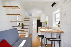 Great layout with two lofts and a small bedroom on first floor. Custom Tiny By Tiny Living Homes