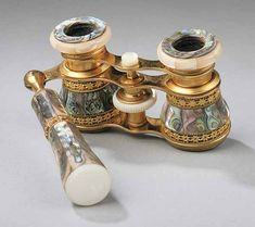 A Pair of French Dark Abalone and Brass Opera Glasses, late 19th c.