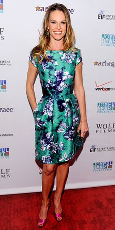 Hilary Swank  WHAT SHE WORE  Swank paired her floral Oscar de la Renta sheath with a turquoise clutch, Vram for Gray Gallery jewelry and satin peep-toes at the Joyful Heart Foundation Gala.