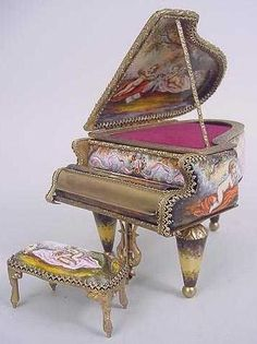 miniature porcelain pianos | On the left is a Capodimonte piece that features a grand piano with ...
