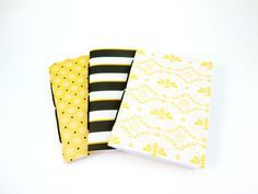 Set of three cute notebooks with bee-themed card stock covers in black, yellow and white. Hand bound using a pamphlet stitch with black twine.  Available in five different sizes: Passport, 3.5 x 4.75 Pocket, 3.5 x 5.5 Personal, 3.75 x 6.75 Standard, 4.25 x 8.25 Cahier, 5 x 8.25 Each notebook includes 30 sheets/60 sides of acid-free, 24 lb/90 gsm bright white paper. This is a very smooth paper thats great for writing or sketching. Choose from lined, dot grid, blank, music, 1/4 graph or…