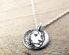 Leo lion necklace in silver by lulubugjewelry on Etsy, $28.00