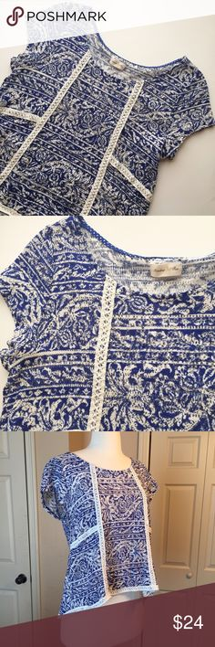 Anthropologie Meadow Rue Knit Blouse Adorable lightweight knit blouse from Anthropologie! Asymmetrical hem which gives it a slight ruffle at the back. The size tag has been cut but it is a size small, pictured on a size 2-4 mannequin. Anthropologie Tops