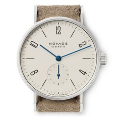 e7dbd497494 Beautiful silver-plated steel watch from Nomos - very minimalistic German  timepiece - SOLETOPIA Look
