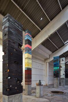 adrián villar rojas stacks mixed material columns at the sharjah biennial