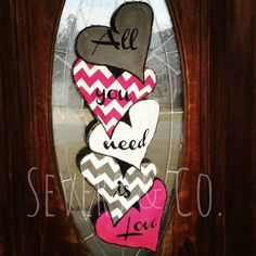 Stack Hearts burlap door hanger by Severs & Co. $40+shipping.