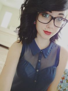 Cant help thinking she looks like Josh Balz. Love the glasses hair and makeup