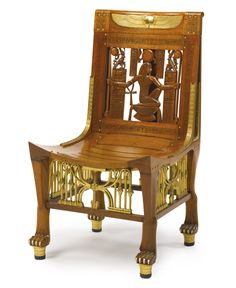 AN EGYPTOMANIA GILT METAL AND IVORY MOUNTED CARVED AND PARCEL GILT WOODEN SIDE CHAIR Cairo, circa 1925 Estimate   8,000 — 12,000  USD  LOT SOLD. 18,750 USD
