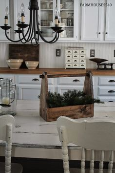 Farmhouse Decorating - a handmade toolbox, placed on the kitchen table, is used to hold seasonal decorations during the holidays - via Farmhouse 5540