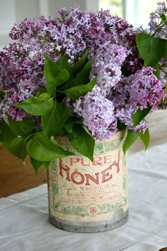 Lilacs in old vintage honey tins.