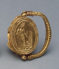 Ring Decorated with a Scarab. Reverse Flat Side: Aphrodite and Eros. Date: Bosporan Kingdom. 330-300s BC. Place of finding: Bolshaya (Large) Bliznitsa Barrow. Archaeological site: Krasnodar Territory, Taman Peninsula, near Vyshestebliyevskaya Cossack Village. Material: gold. Technique: cast, stamped, chased, engraved and filigreed.