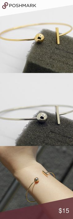 GoldSilver Fashion Bangle Very trendy T bangle with a ball! Available in silver and gold! Looks beautiful worn by itself or stacked with other jewelry! Very simple and delicate but adds to the arm candy! Jewelry Bracelets