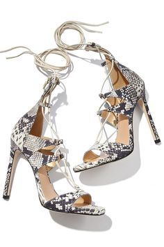 Take a walk on the wild side with exotic shoe styles by Stuart Weitzman.