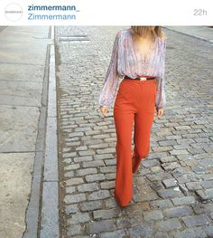 "82daf17701e6a zimmermann-sydney: "" Mercer St: Renee in our Soho store wears Arcadia Braid  Swing Top, High Waisted Pant in Rust and Waist Slide Snake Belt."