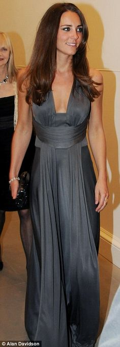 Kate Middleton, now Duchess of Cambridge, is stylish on trend in a gunmetal grey dress with a deeply cut neckline by ISSA.