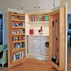 Love this first floor hidden laundry with tons of storage !