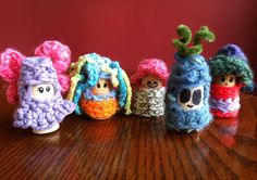My daughter outfitted these adorable cork people with her own crochet designs...