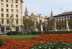 """The Plaza de Catalunya, a large plaza surrounded by monumental buildings, is Barcelona's busiest square (It is actually """"round""""). It is located between the old city (Ciutat Vella) and the 19th century Example district. The statue to the ffar left is  Barcelona Airport Private Arrival Transfer ! , Costa Brava & Catalunya The Catalan architec"""